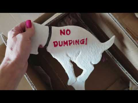 How to keep the neighbors dog from pooping on my lawn?